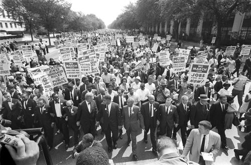 """WASHINGTON, :  US civil rights leader Martin Luther King,Jr. (3rd from L) walks with supporters during the """"March on Washington"""" 28 August, 1963 after which, King delivered the """"I Have a Dream"""" speech from the steps of the LIncoln Memorial. 28 August, 2003 marks the 40th anniversary of the famous speech, which is credited with mobilizing supporters of desegregation and prompted the 1964 Civil Rights Act. King was assassinated on 04 April 1968 in Memphis, Tennessee. James Earl Ray confessed to shooting King and was sentenced to 99 years in prison.  AFP PHOTO/FILES (Photo credit should read AFP/AFP/Getty Images)"""